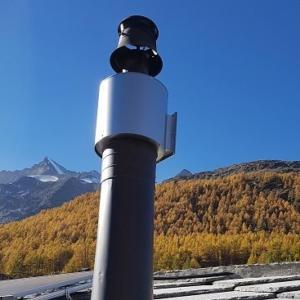 Weniger Feinstaub aus Holzfeuerungen in Saas-Fee dank Elektroabscheidern
